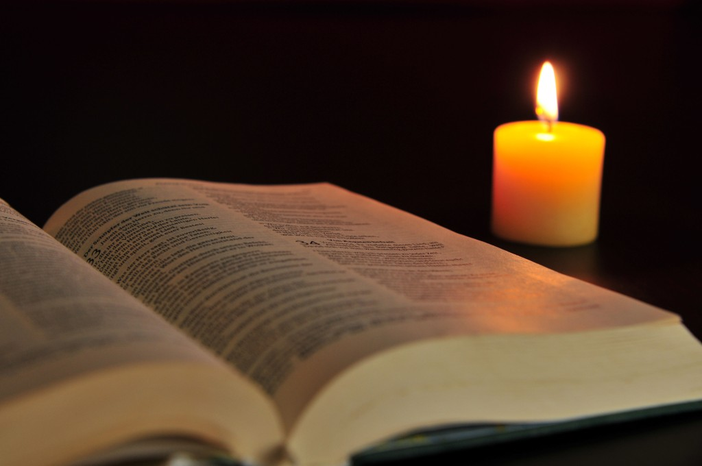 Bible on table with Candle